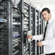 Stok fotoğraf: Business man practice yoga at network server room
