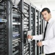 Stock Photo: Business man practice yoga at network server room