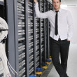 Business man practice yoga at network server room — Stock Photo #4791942