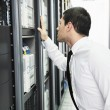 Business man practice yoga at network server room — Stockfoto