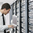 Business man practice yoga at network server room - Stockfoto