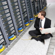 Royalty-Free Stock Photo: Business man practice yoga at network server room