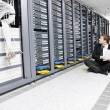 Business man practice yoga at network server room — Stock fotografie
