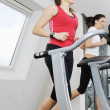 Woman workout in fitness club on running track — Stock Photo