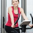 Woman workout in fitness club on running track — Stock Photo #4794905