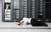 Business man practice yoga at network server room — Stock Photo