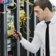 Young it engeneer in datacenter server room — Stock Photo #4801590