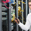 Young it engeneer in datacenter server room — Stock Photo #4801592