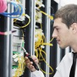 Young it engeneer in datacenter server room — Stock Photo #4801613