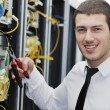 Young it engeneer in datacenter server room — Stock Photo #4801634