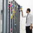 Young it engeneer in datacenter server room — Stock Photo #4801791