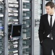 Young it engeneer in datacenter server room — Stockfoto