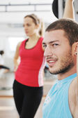Happy young couple fitness workout and fun — Stock Photo