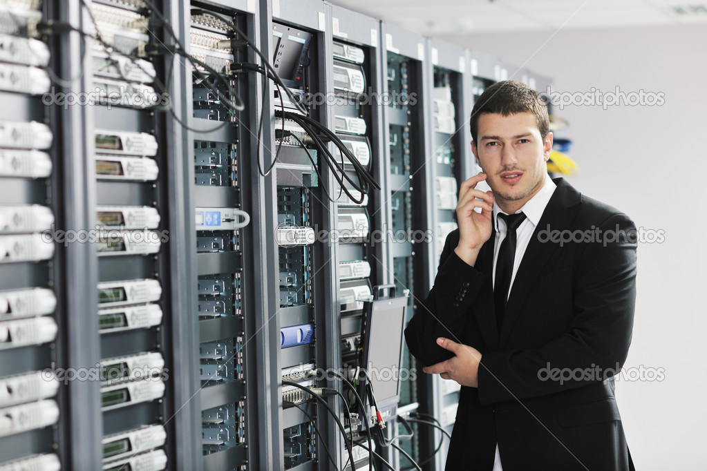Young handsome business man it  engeneer in datacenter server room — Stock Photo #4801332