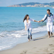 Happy young couple have fun at beautiful beach — Stock Photo