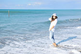 Happy young woman on beach — Stock Photo