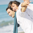 Happy young couple have fun at beautiful beach — Stock Photo #4830272