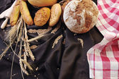 Fresh bread and wheat food group — Stock Photo