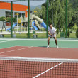 Young man play tennis outdoor — Stock Photo #4907259