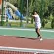 Young man play tennis outdoor — Stock Photo #4907313