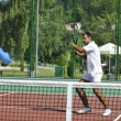 Young man play tennis outdoor — Stock Photo #4907341