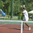 Young man play tennis outdoor — Stock Photo #4907371