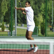 Young man play tennis outdoor - Stock Photo