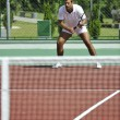 Young man play tennis outdoor — Stock Photo #4907585