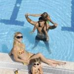 Beautiful woman relax on swimming pool — Stock Photo #4908547