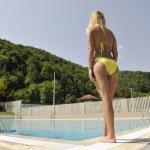 Beautiful woman relax on swimming pool — Stock Photo #4909052