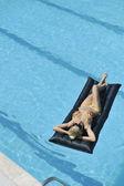 Beautiful woman relax on swimming pool — Stock Photo