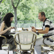 Happy young couple eat at restaurant — Stock Photo