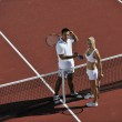 Happy young couple play tennis game outdoor — Stock Photo #4948664
