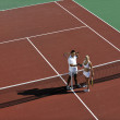 Happy young couple play tennis game outdoor — Stock Photo #4948710