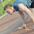 Young athlete on start — Stock Photo