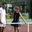 Happy young couple play tennis game outdoor — Stockfoto