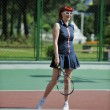 Young woman play tennis game outdoor — ストック写真