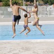 Happy young family have fun on swimming pool — Stock Photo #4979747