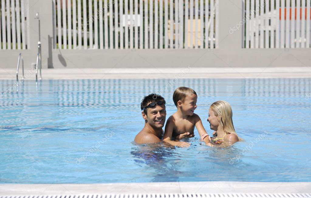 Happy young family have fun on swimming pool  at summer vacation — Stock Photo #4975405