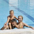 Happy young family have fun on swimming pool — Stock Photo #4980261