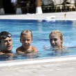 Happy young family have fun on swimming pool — Stock Photo #4980351