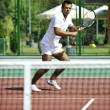 Young man play tennis outdoor — Stock Photo #4984985