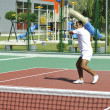 Young man play tennis outdoor — Stock Photo #4985374