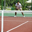 Young man play tennis outdoor — Stock Photo #4985837