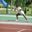 Young man play tennis outdoor — Stock Photo #4985879