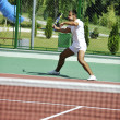 Young man play tennis outdoor — Stock Photo #4985904