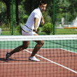 Young man play tennis outdoor — Stock Photo #4985932