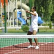 Young man play tennis outdoor — Stock Photo #4985992