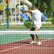 Young man play tennis outdoor — Stock Photo #4986010