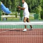 Young man play tennis outdoor — Stock Photo
